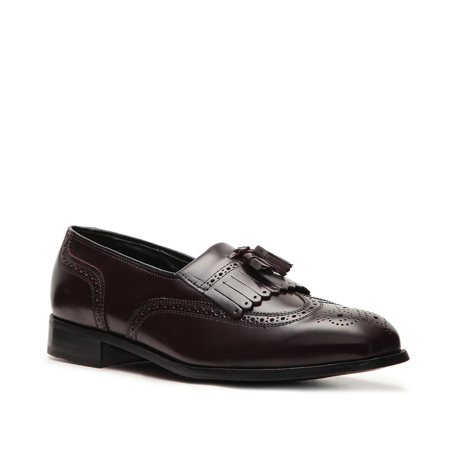 Walk confident in the Lexington loafer fromFlorsheim! This classic slip-on featureswingtipand brogue styling with a kiltie tassel for an added twist.