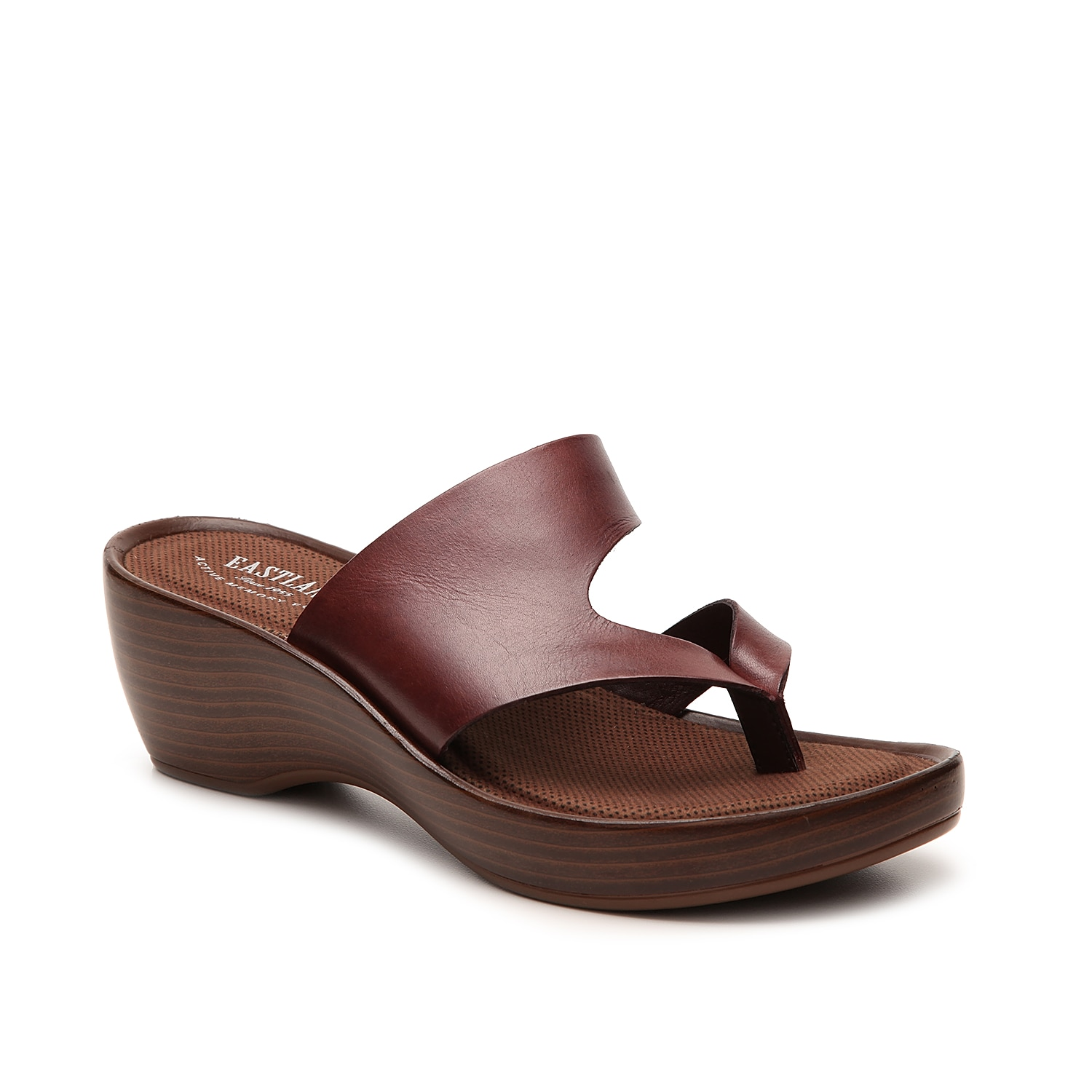 Slide into a versatile leather sandal designed for both comfort and style! With a plush memory foam footbed, the Eastland Laurel thong sandals are the perfect wedges for all day casual wear.