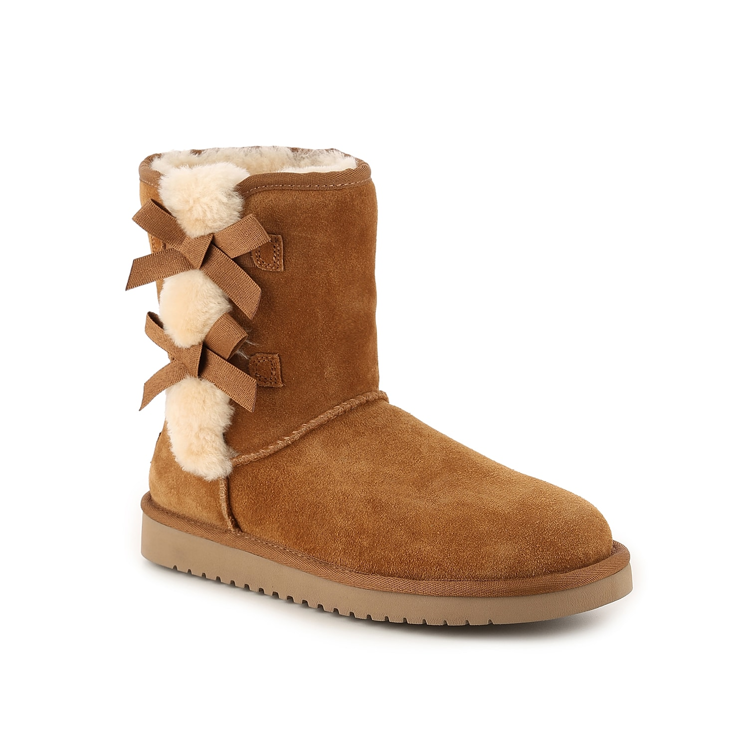 Stay warm and cozy all season long in these suede shearling booties from Koolaburra by Ugg. Pull on the Victoria Short winter boot over jeans or leggings for a comfy look.Click here for Boot Measuring Guide.