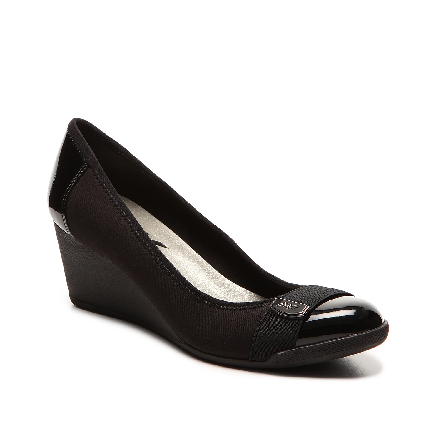 Take style and comfort to the next level with AK Anne Klein Sport. The Tatum wedge pump has patent accents, perfect for your sophisticated looks.