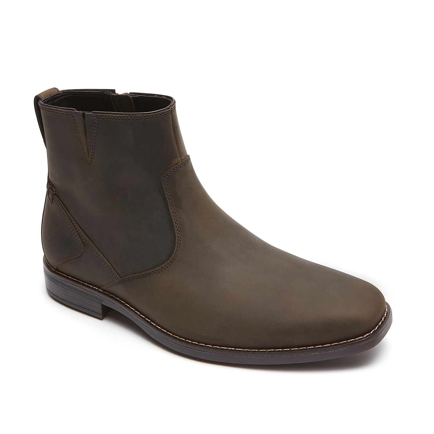 Add a contemporary cool finish to your casual attire with the Travis from Rockport. This leather boot will keep your feet happy and comfortable!