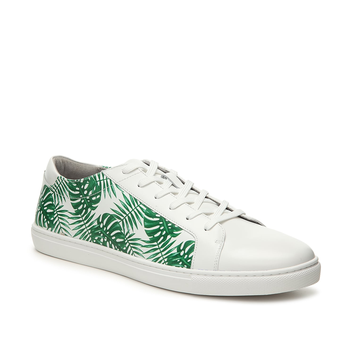 Add subtle style to your shoe collection with the Kam Leaf sneaker from Kenneth Cole New York. This low-top features a leaf printed leather finish that will go great with jeans and a bomber jacket!