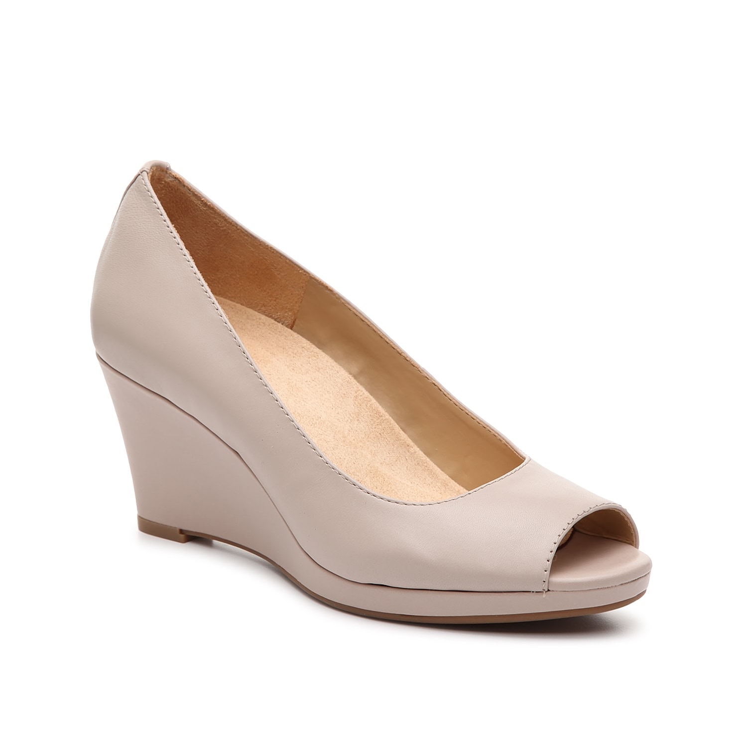Dress up your ensemble with the Sienna wedge pump from Naturalizer. The clean, leather construction and peep toe will show off your perfectly painted toe nails!