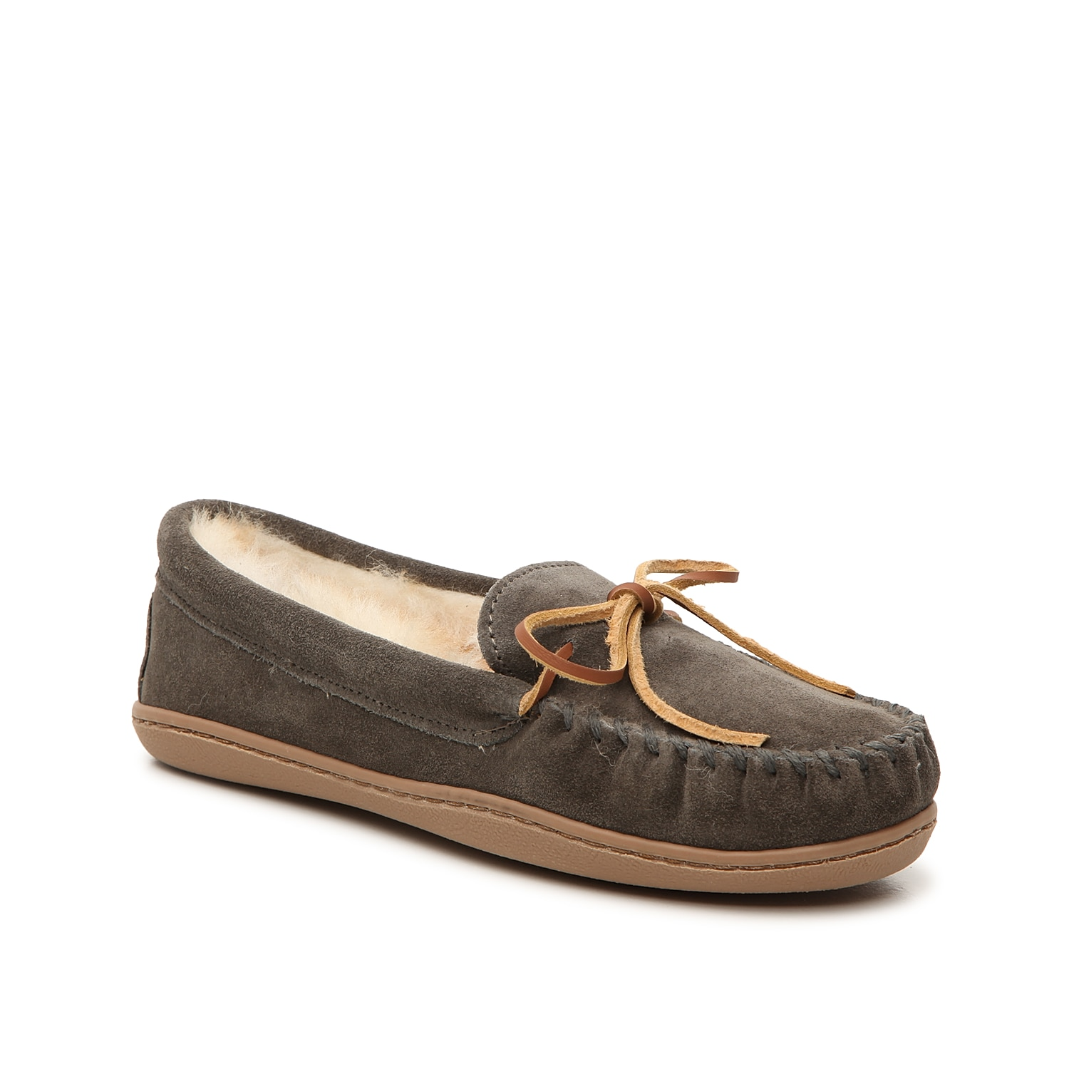 Make your lounge-worthy look extra comfy in the Sheepskin moccasin slipper from Minnetonka. These hard-sole slip-ons feature a soft suede construction and warm sheepskin lining that are sure to become your new go-to.