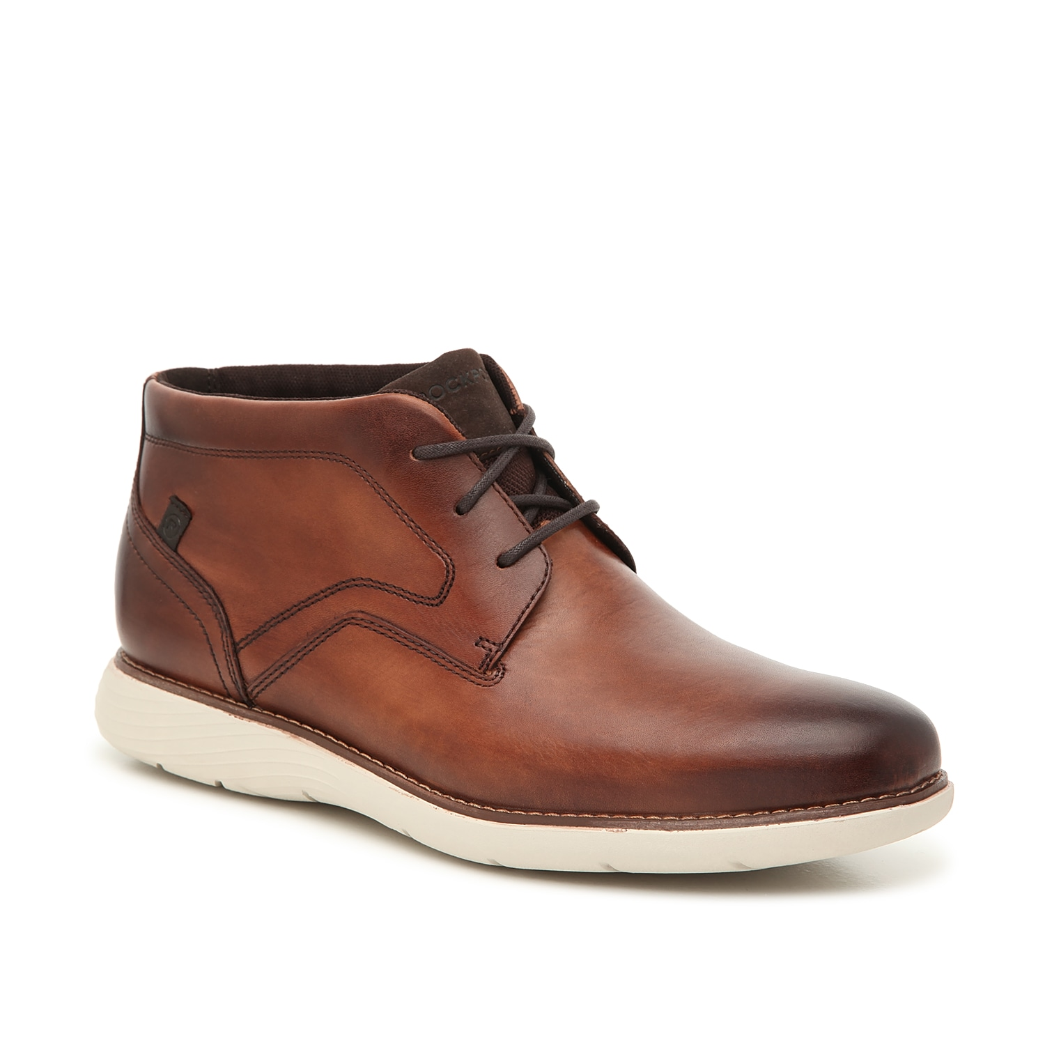 Bring versatility to any look in the Garett chukka boots from Rockport. These leather mid-tops feature truTECH® cushioning and a supportive midsole to keep you feeling on top from day to night.