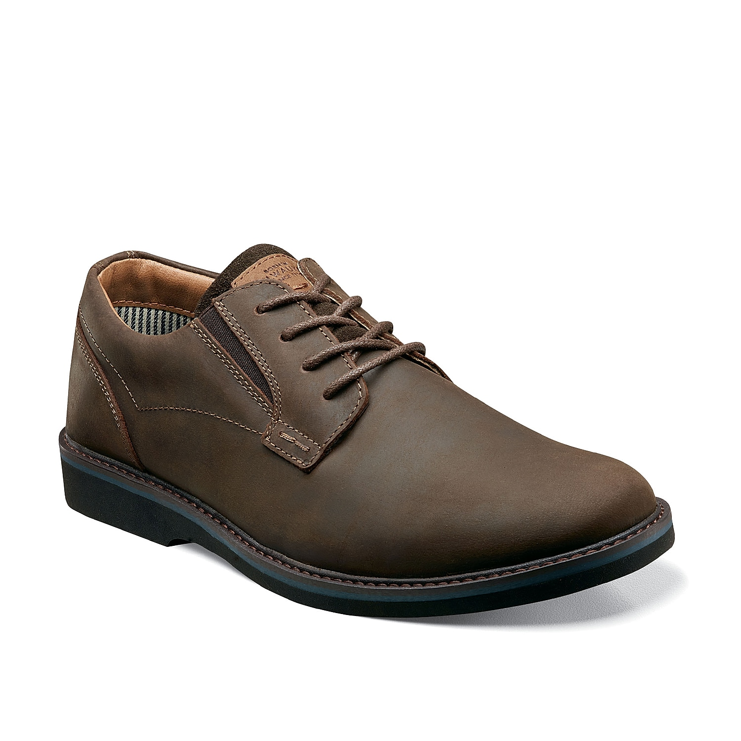 Stay on top of your style with the Barklay oxford from Nunn Bush. These leather dress shoes feature an elastic insert for a custom fit and are finished with a memory foam footbed for daylong comfort and support.