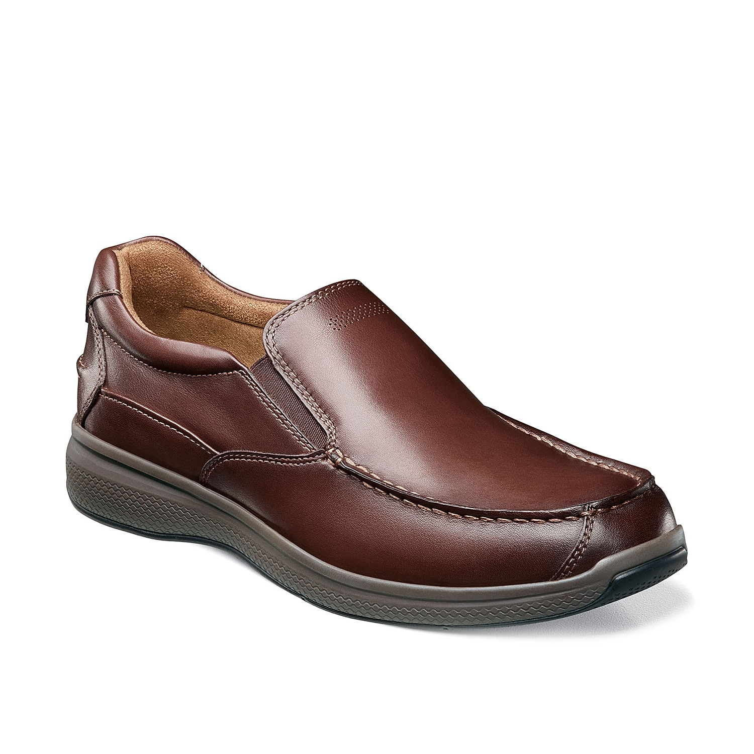 Add a casual accent to your work or night-out attire in the Great Lakes loafer from Florsheim. These slip-ons feature perforated detailing for a modern touch and are finished in rich leather for lasting wear.