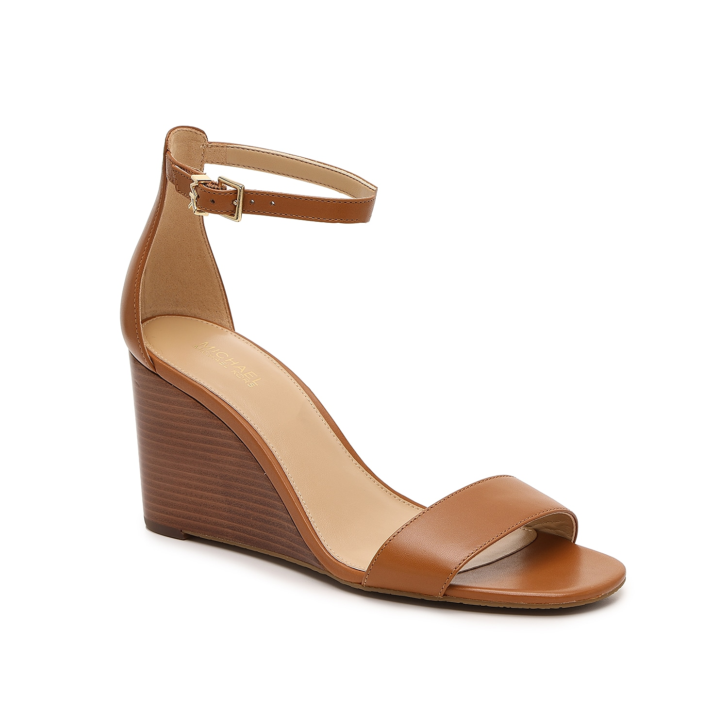 Strut your stuff with the leather Fiona wedge sandal from Michael Michael Kors. This elevated pair is fashioned with a squared off toe and stacked heel for all the heel!
