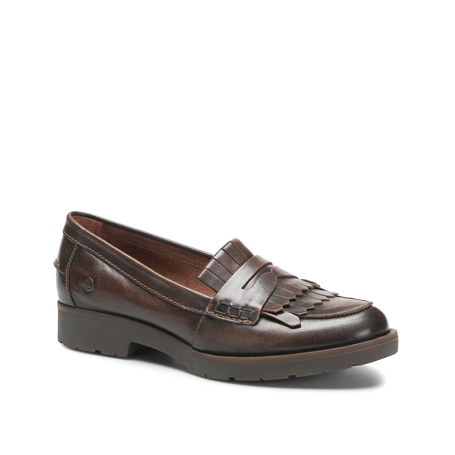 Feel refined in the Lorens penny loafer from Born. These leather slip-ons feature a classic kiltie accent and molded block heel that add eye-catching enticement to cropped slacks or a knee-high skirt.
