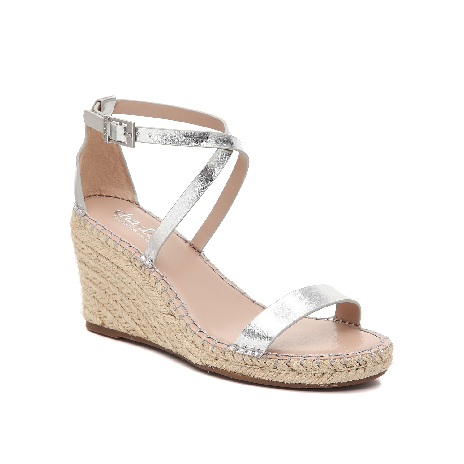 Feel sophisticated and fun in the Nola sandals from Charles by Charles David. This pair features crisscross straps at the ankle and an espadrille wedge heel for textural enticement.