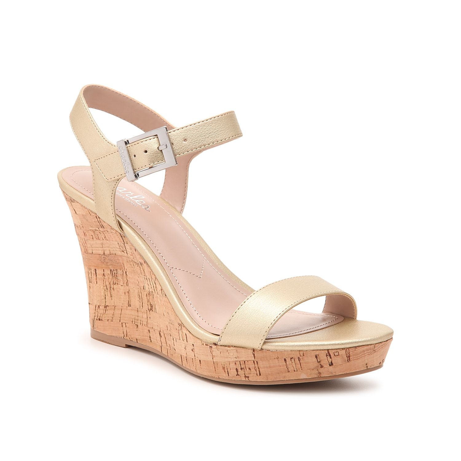 Change up your style with the Lindy wedge sandal from Charles by Charles David. This two-piece pair is fashioned with a gold metallic hue and a cork heel that will complete your entire look!