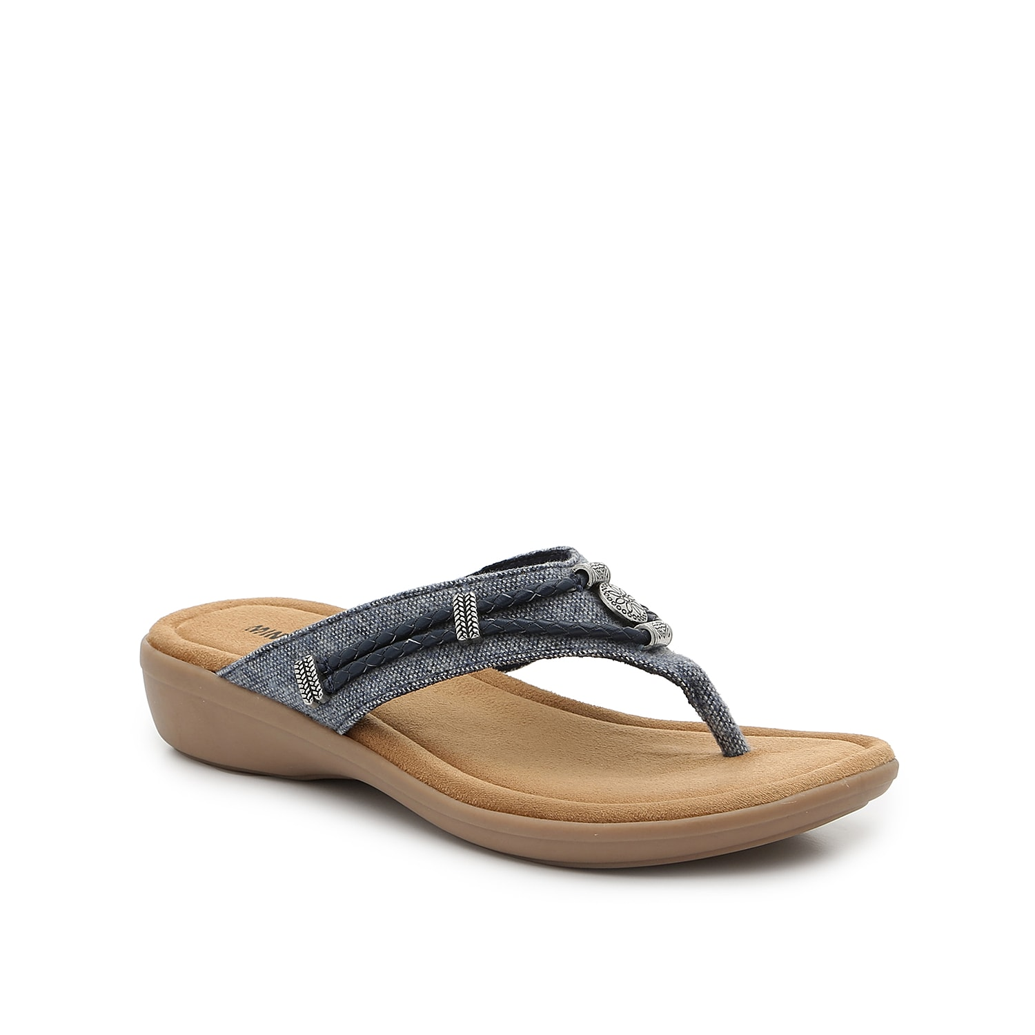 The Silverbay thong sandals by Minnetonka offer comfort and style all in one! Slide into these versatile wedges for an understated, casual look.