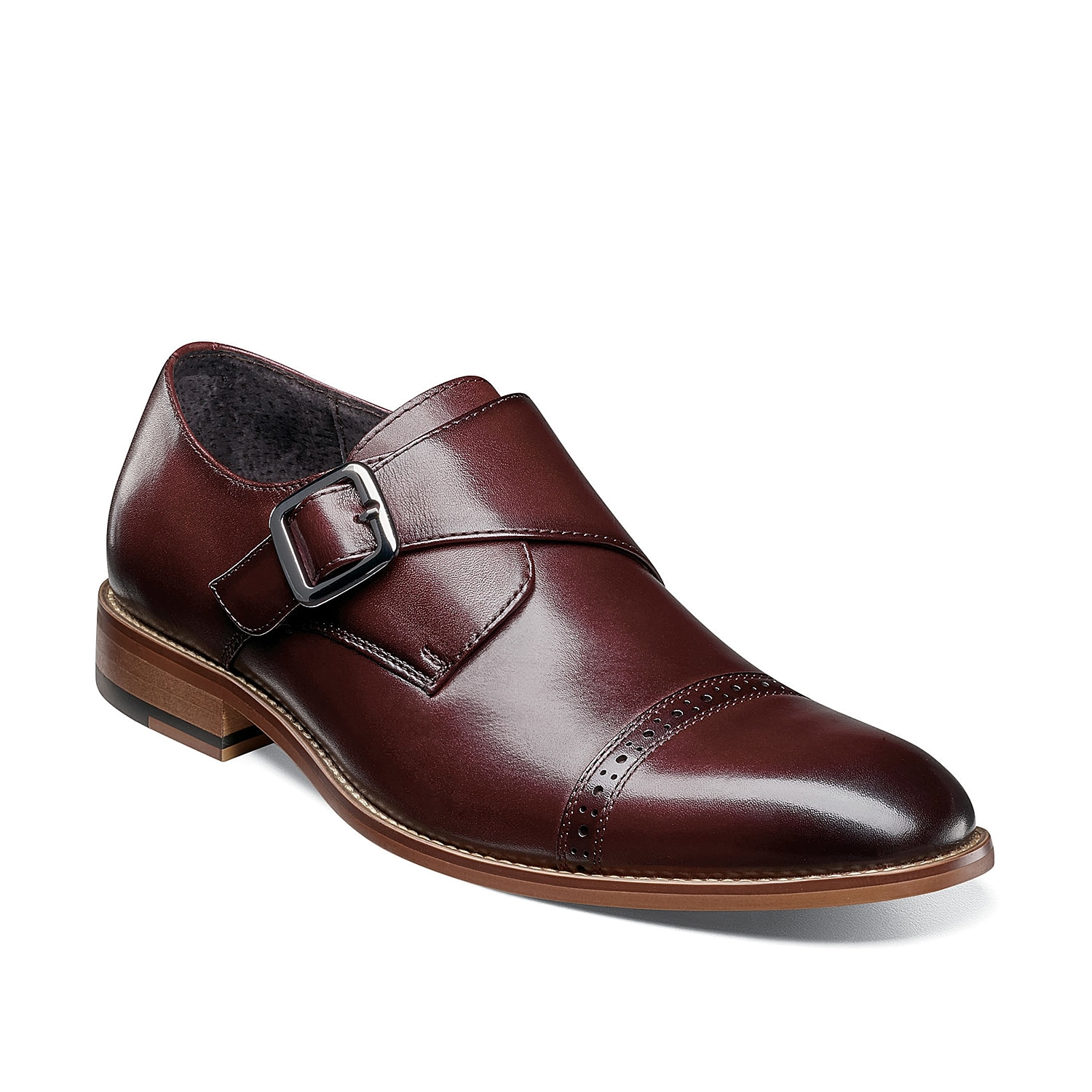 Sophistication comes easy with the Desmond monk strap slip-on from Stacy Adams. This leather pair features a perforated cap toe for added interest.
