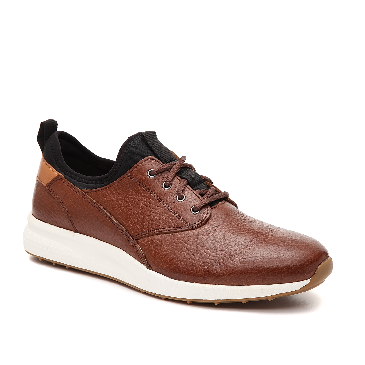 Pair the Keating sneaker from Johnston & Murphy with any of your casual to dressy outfits. This low-top pair features a pebbled, leather upper and a nylon lining that will easily match with your rotating wardrobe.
