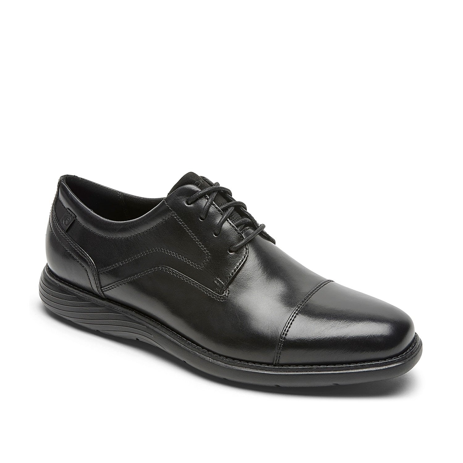 Bring a versatile look to your outfit with the Garrett oxford from Rockport. This lace-up pair features a round cap toe and a TruTECH®footbed for comfortable steps!