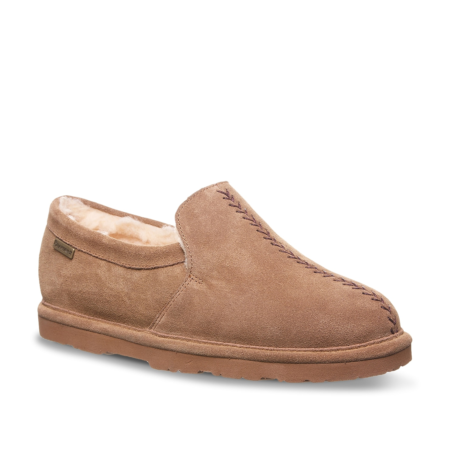 Kick back and relax when wearing the Jayden slippers from Bearpaw. This suede pair features a warm wool-blend lining and is topped off with NeverWet®technology to keep your feet dry.