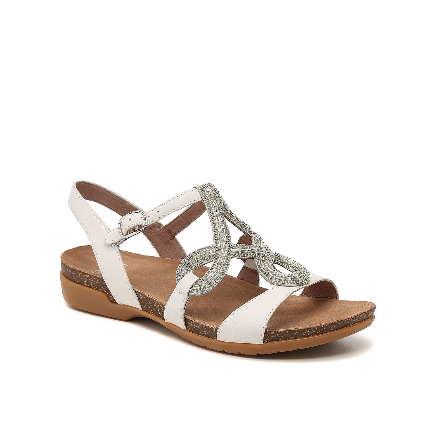 Styled with a beaded fleur-de-lis design, the Reeta sandals from Dansko elegantly blend feminine fashion with comfort features. A sturdy outsole provides grip and sure-footing, while an all-leather upper for lasting wearability.