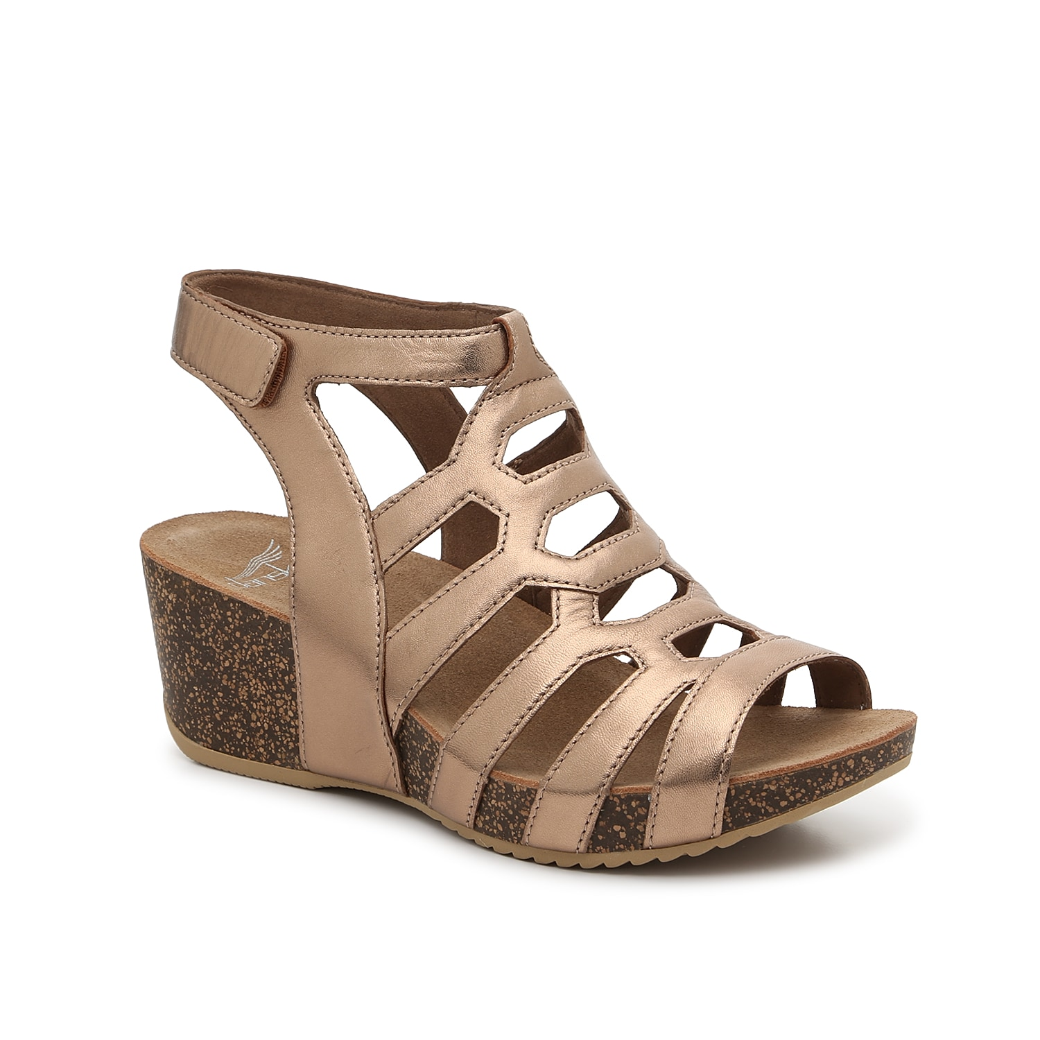 Stylish and supportive, the Selina wedge sandal from Dansko will become an instant favorite. Featuring a breathable leather lining and molded footbed, this cut-out pair complements all your outfits!