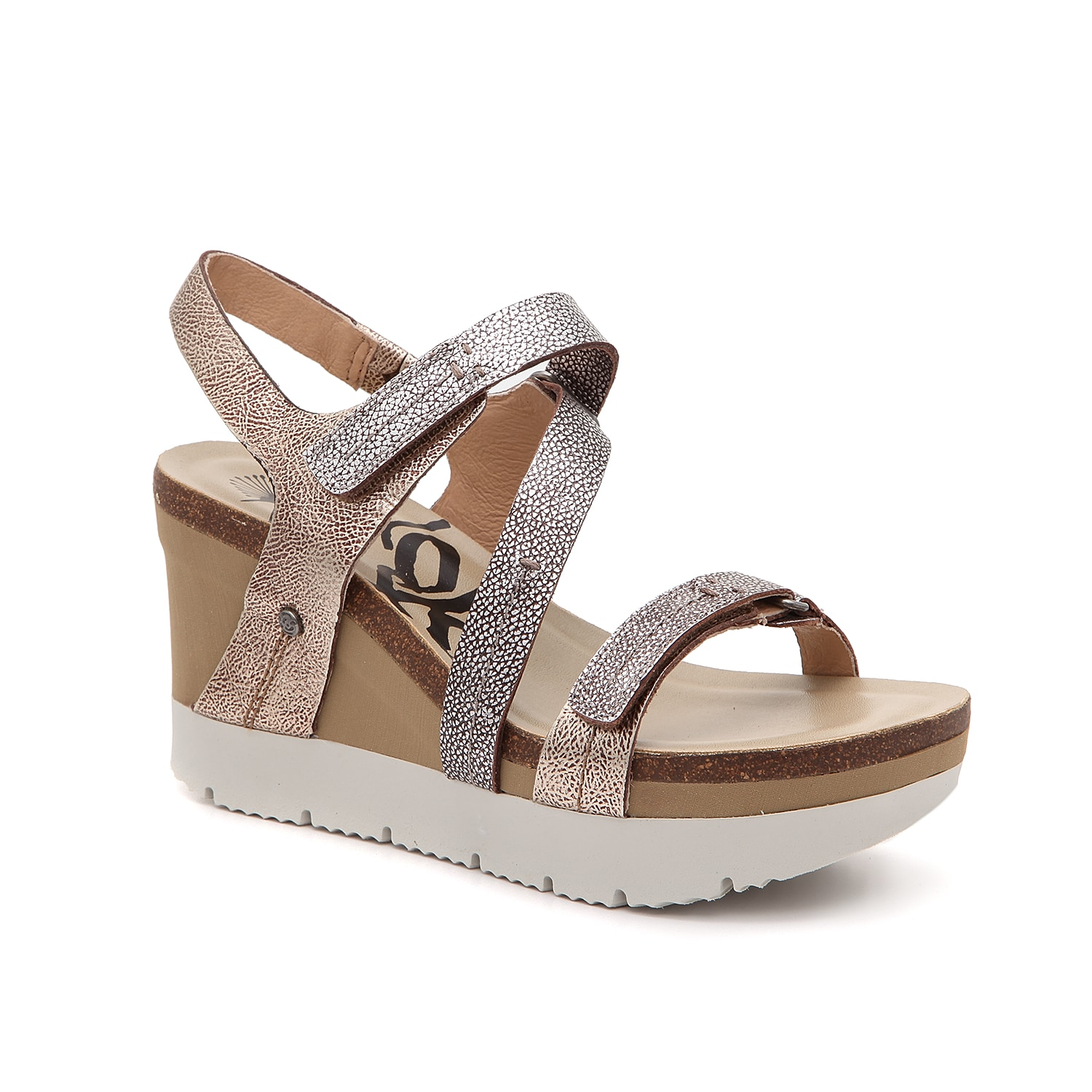 Take your look to a new level with the Wavey sandal from Otbt. These wedges feature smooth leather straps and a cushioned footbed to give optimal support all day.