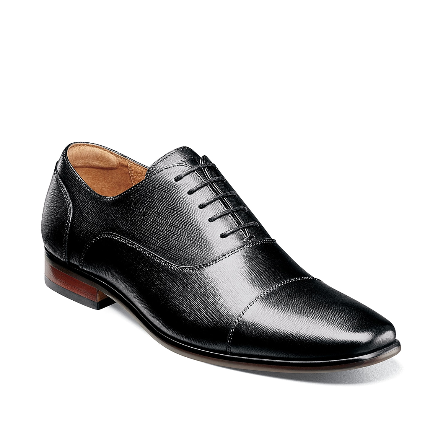 Showcase your tailored style with the Postino cap toe oxford from Florsheim. Textured leather is finished with clean stitched accents for added sophistication.