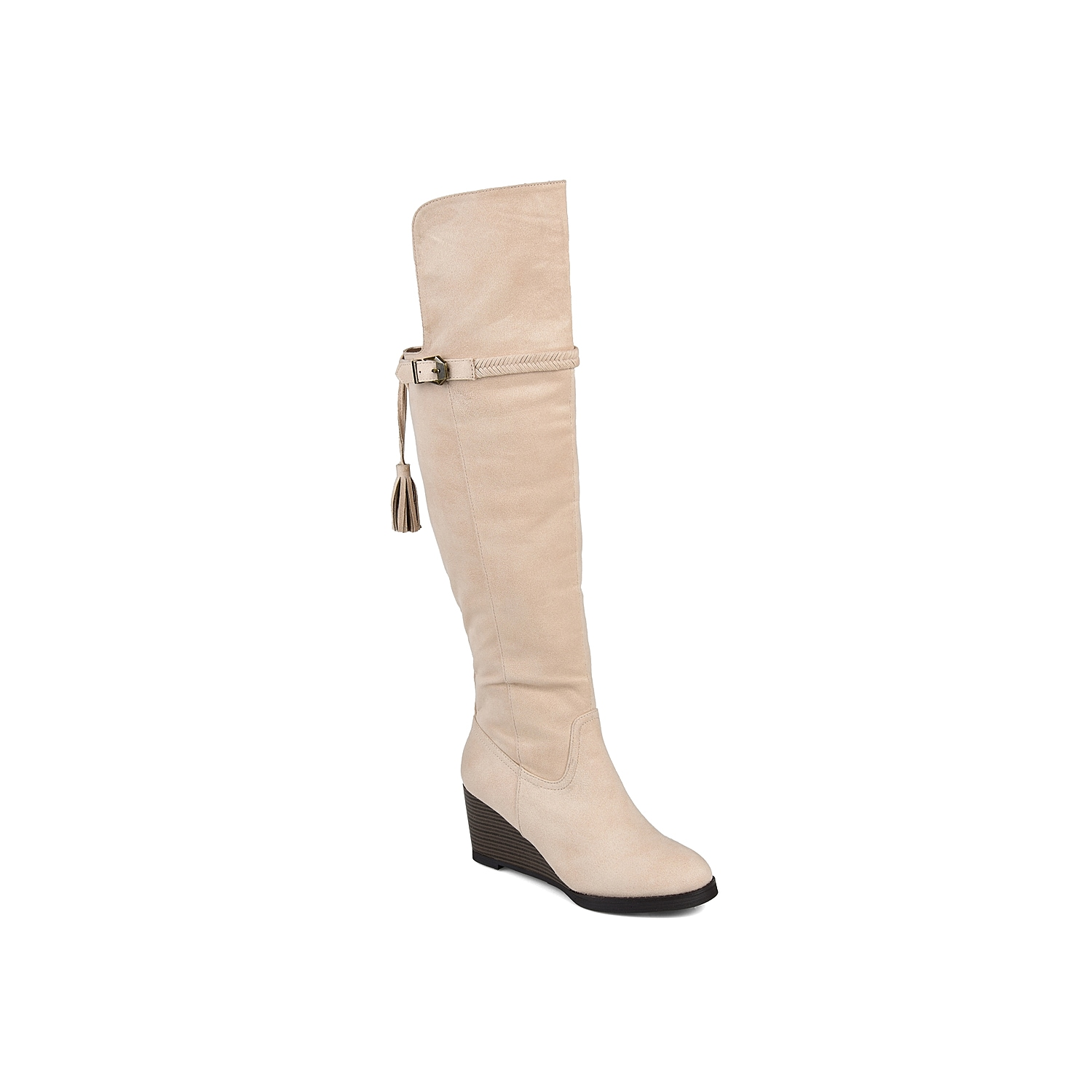 Make a serious style statement with the Jezebel over the knee boot from Journee Collection. With an asymmetrical topline and tassel accent, this tall wedge boot will add unique style to any outfit.Click here for Boot Measuring Guide.