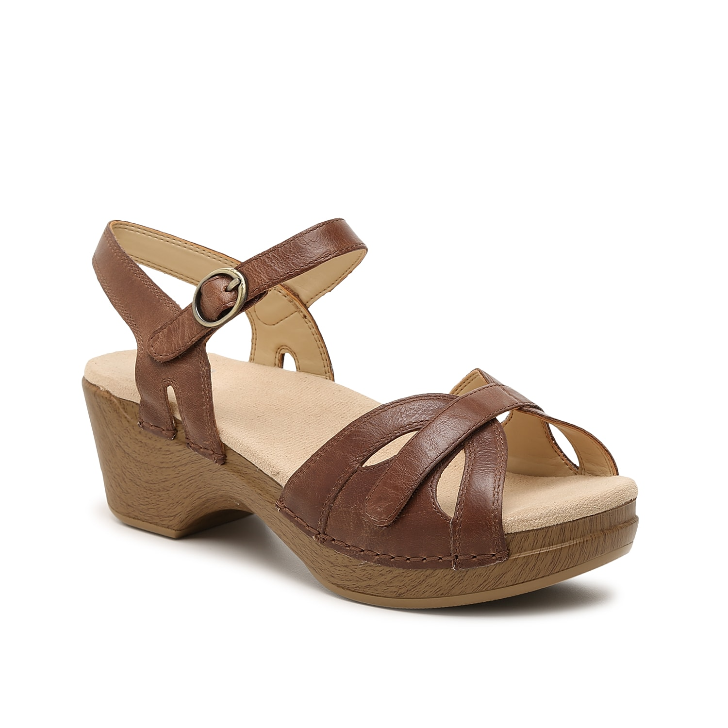 The Season platform sandal from Dansko will upgrade your warm weather look. Fisherman-style straps in genuine leather add lasting quality while a faux wood finish on the heel looks traditional and timeless.