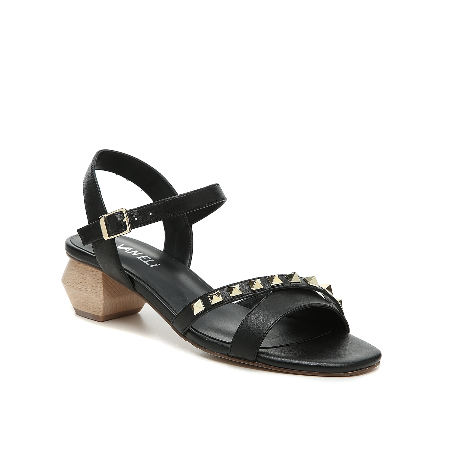 Show off your fashion-forward looks with the Cidin sandal from VANELi. This silhouette is fashioned with a leather upper, edgy stud accent, and a geometric heel for added interest!
