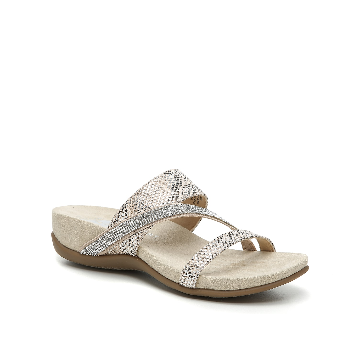 Feel nothing but comfort when wearing the Durand wedge sandal from Anne Klein Sport. The cushioned foam midsole and asymmetrical rhinestone strap keeps you feeling your best from day-to-night!