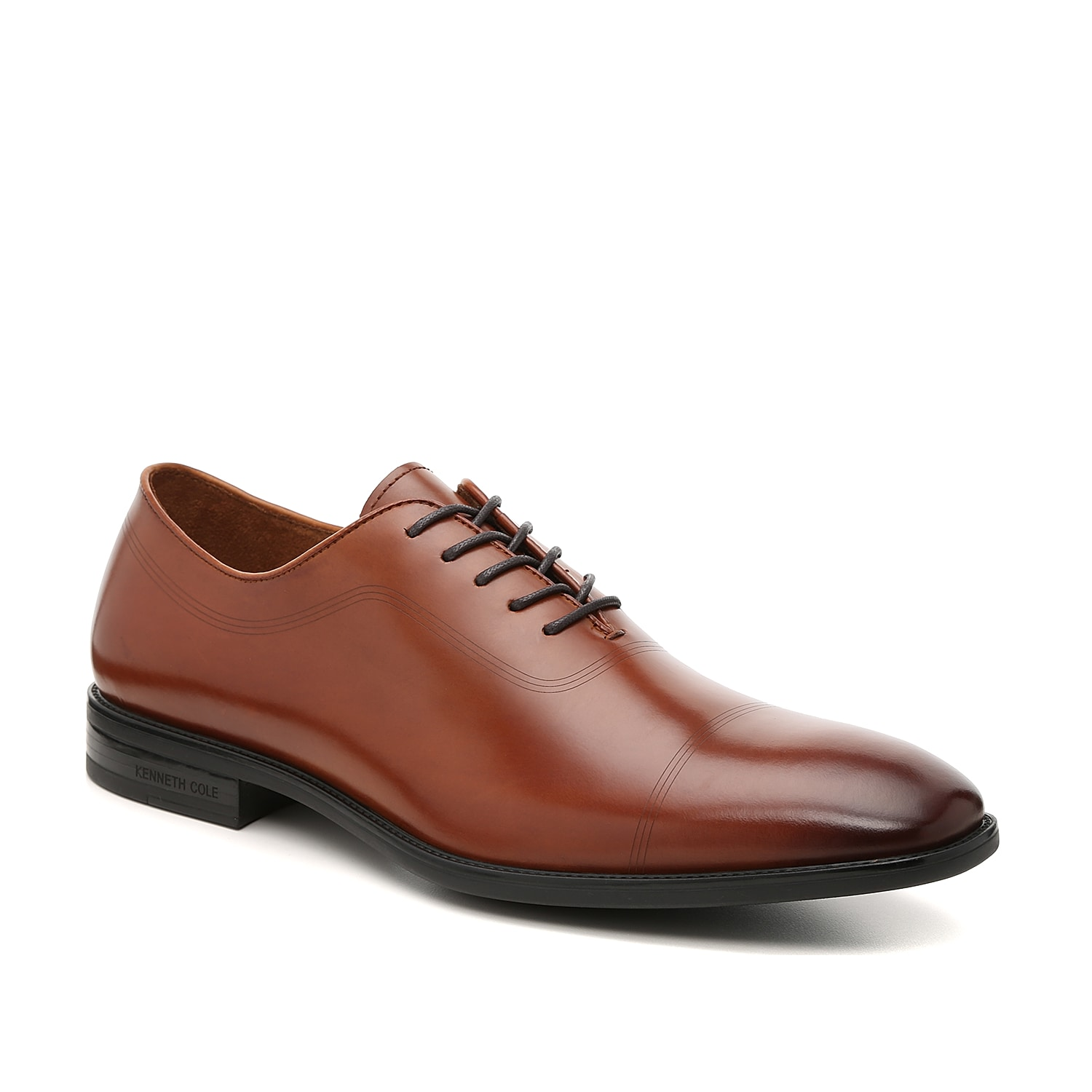 Modernize work or date night looks with the Kenneth Cole New York Ticketpod oxford. These dress shoes feature a sleek leather upper and is detailed with thin laser-cut lines that complement slacks and a fitted blazer.