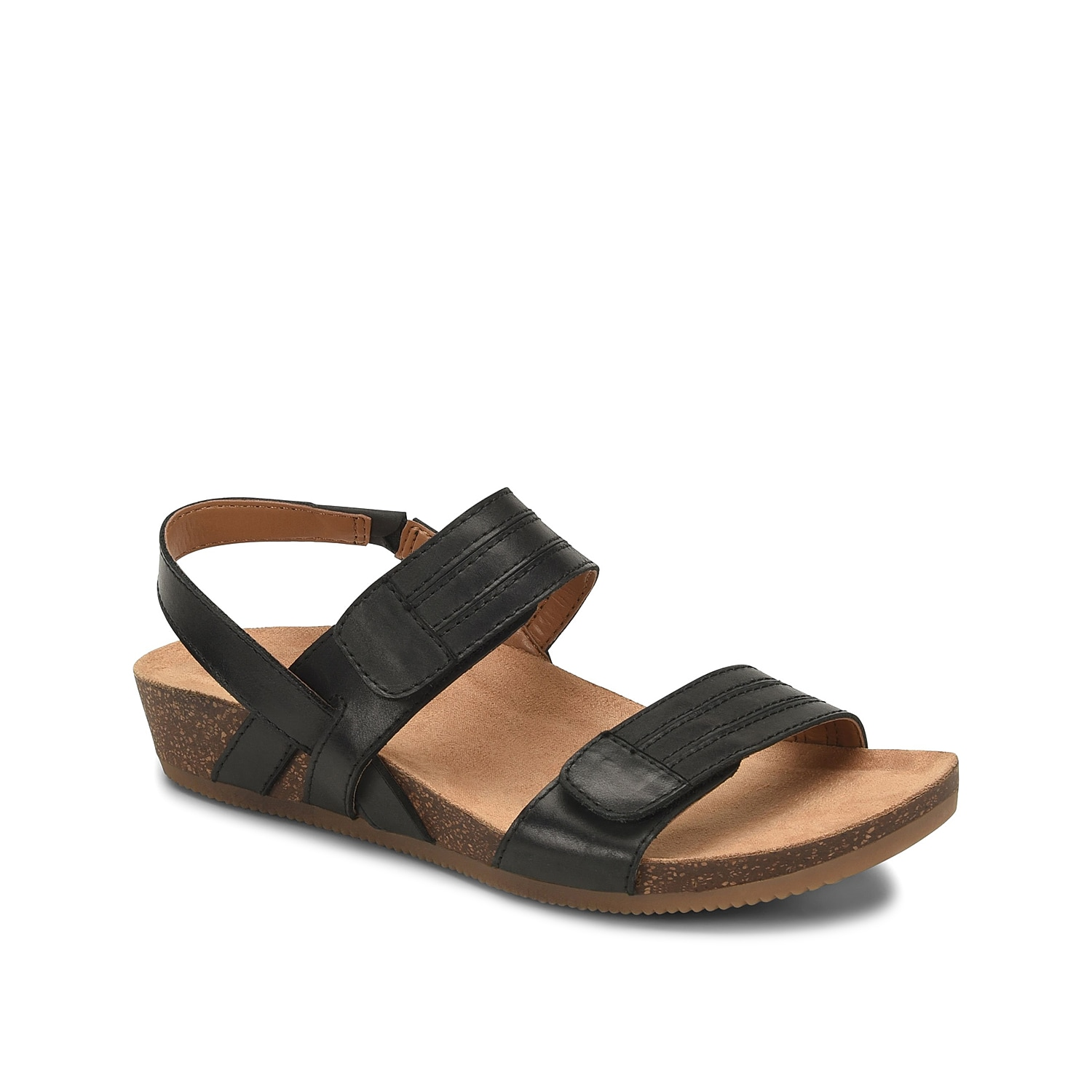 Upgrade your wardrobe with the Gevira wedge sandal from Comfortiva. This leather pair features secured hook and loop straps and a cushioned footbed for daylong wear!