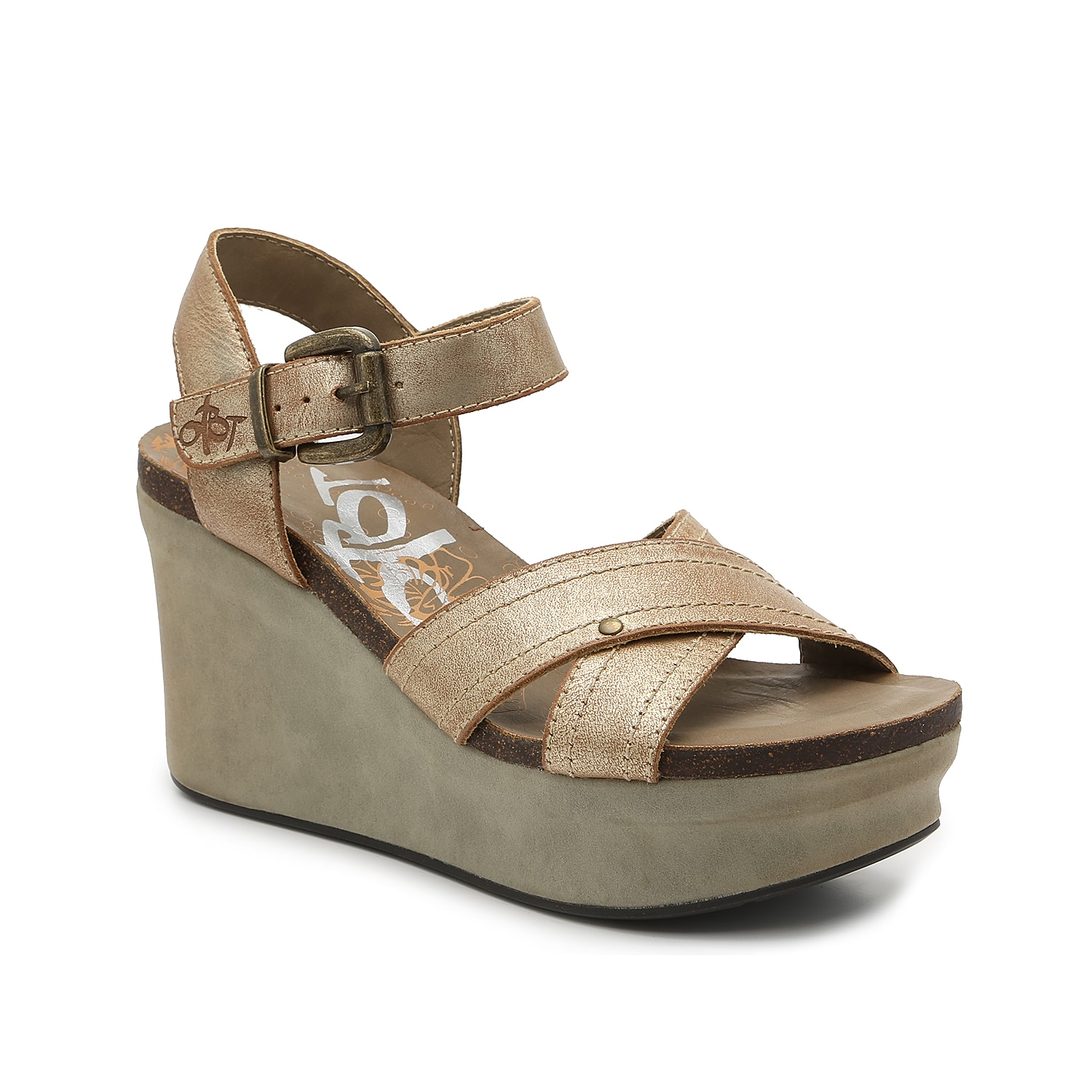 Lift your look in a modern way with the Bee Cave wedge sandal from Otbt. With crisscross straps and a cork midsole, this leather pair will complement all your jeans, skirts, or dresses.