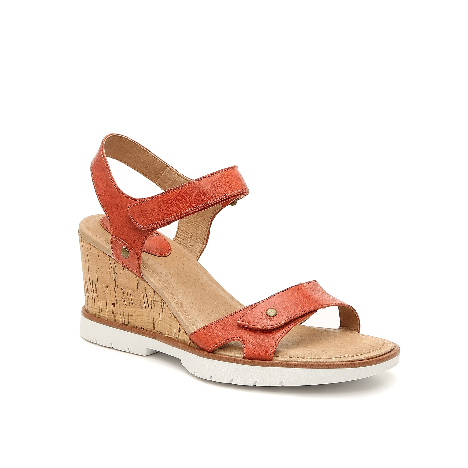 A two-piece design improves the athletic fit of the Cyndy sandals from Sofft. Paired with a sporty vulc sole in contrasting white, these wedges capture classic charm with a cork-covered heel.
