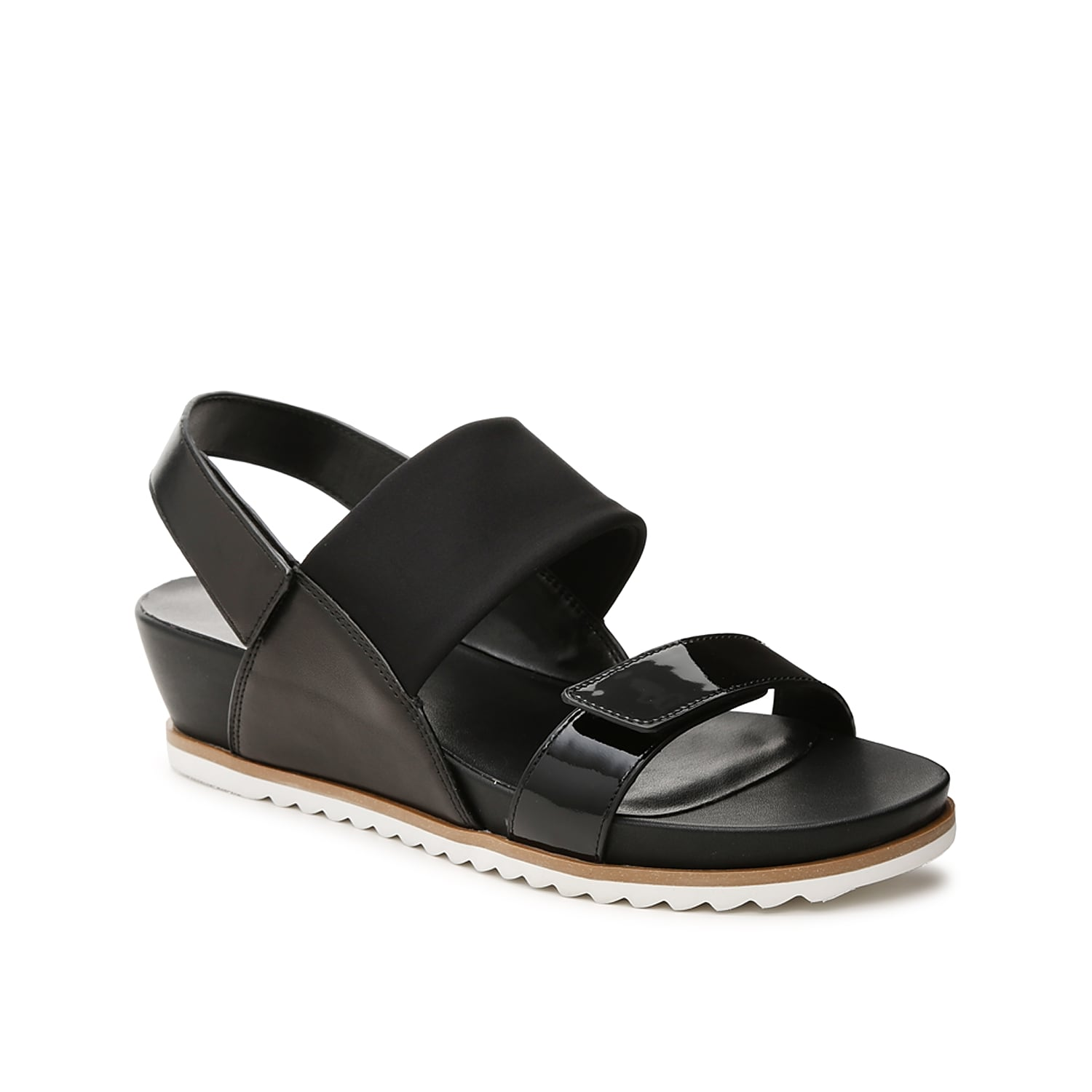 The Hayley wedge sandal from VANELi is easy to pair with anything from dresses to capris. A cushioned footbed keeps you comfortable while the hook and loop straps offer a custom fit.