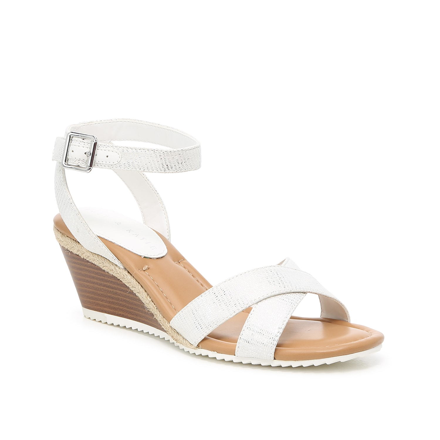 Sweet style comes naturally when stepping out in the Emmaline wedge sandal from Kelly & Katie. The two-piece silhouette is paired with a natural espadrille trim and sporty sawtooth sole in contrasting white.