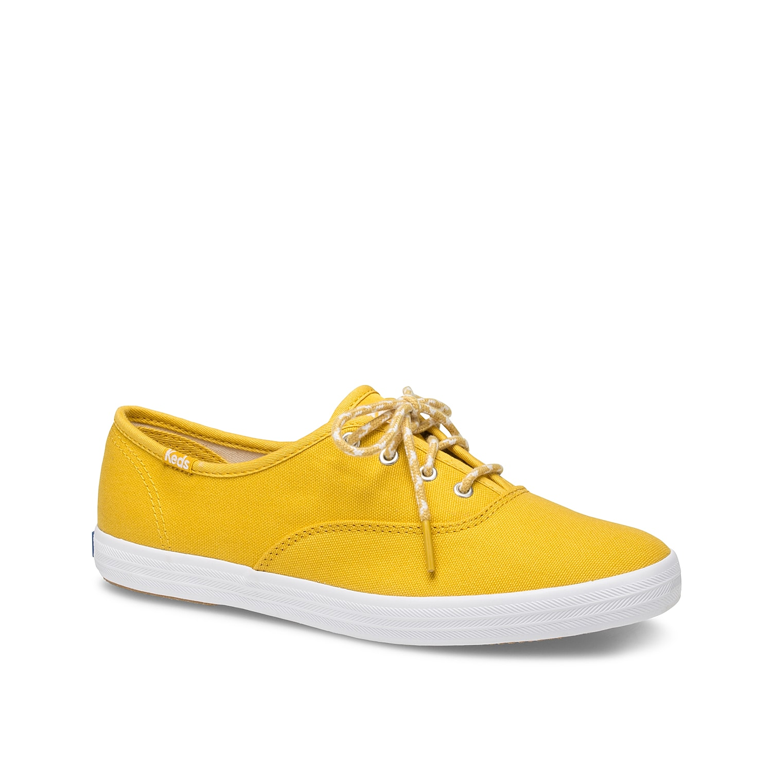 Be ready for whatever the day brings you in the Champion sneaker from Keds. Crafted from canvas, this lace-up profile features soft breathable lining for added comfort and flexible textured sole that ensures reliable footing.