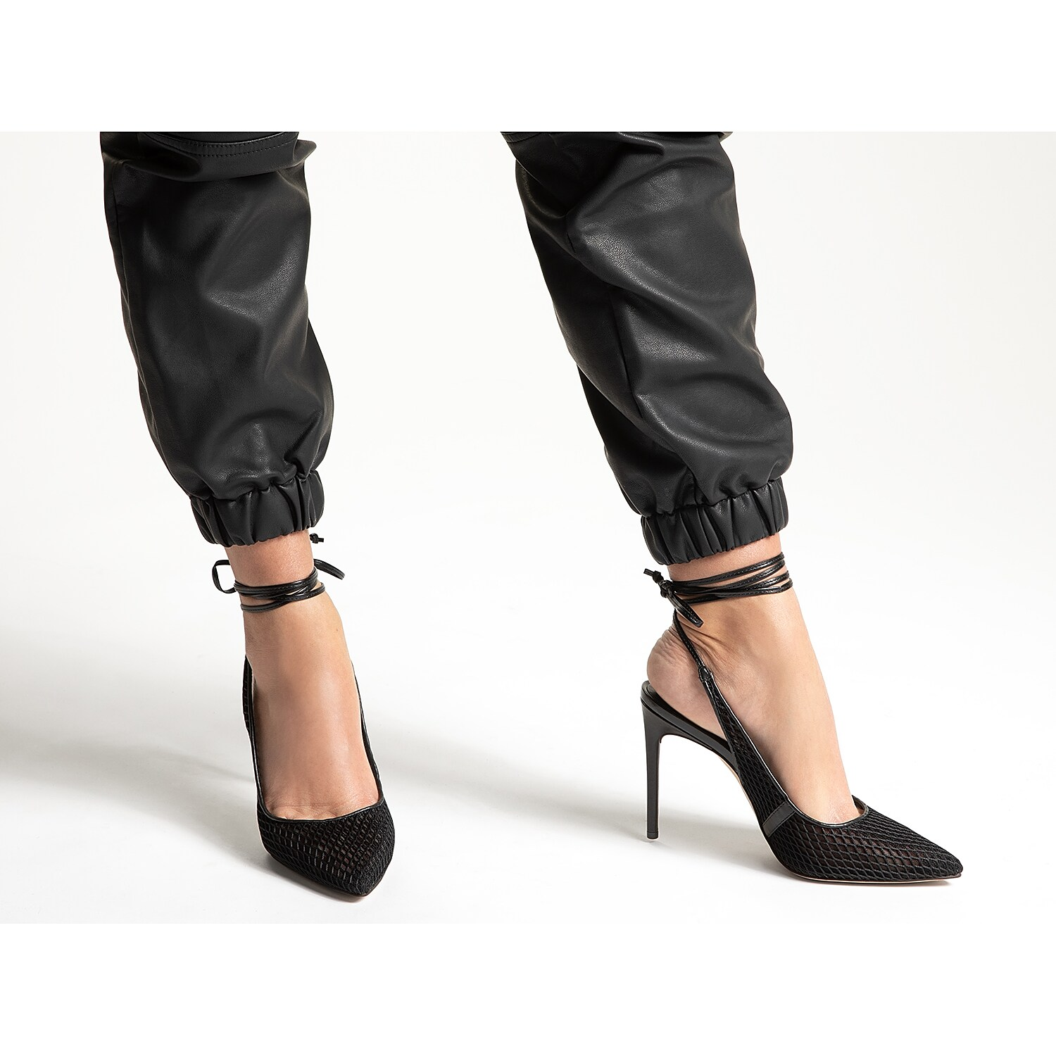 A spiked power heel and skinny ankle straps bring iconic sizzle to the Florella ultra-high pumps from JLO Jennifer Lopez. Backless styling reveals plenty of skin while providing just enough coverage at the pointed toe.