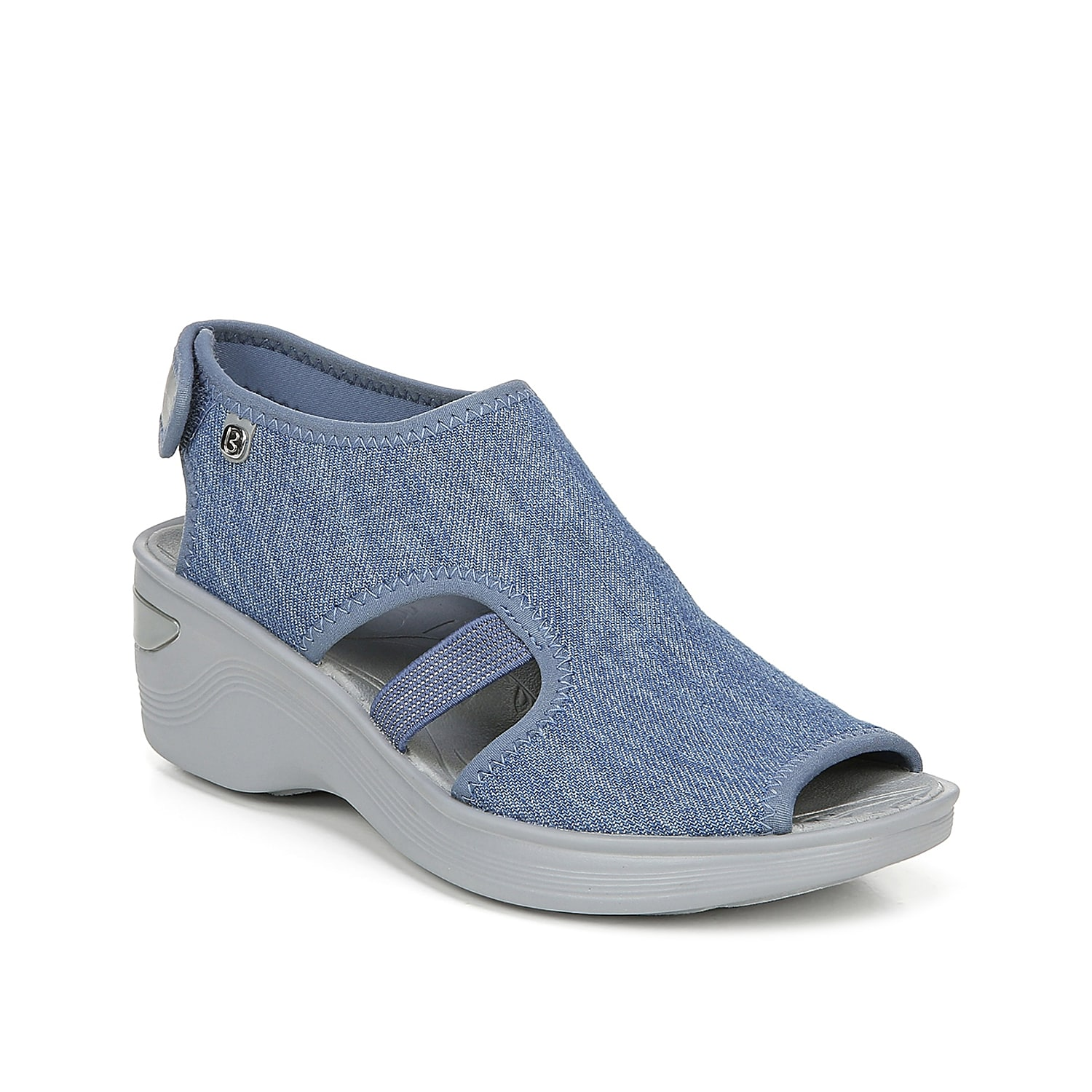 Take your shoe collection to new heights with the Dream wedge sandal from BZees. This silhouette is fashioned with chambray upper and a chunky midsole that will go great with anything from playful dresses to jeans and an easy tee!