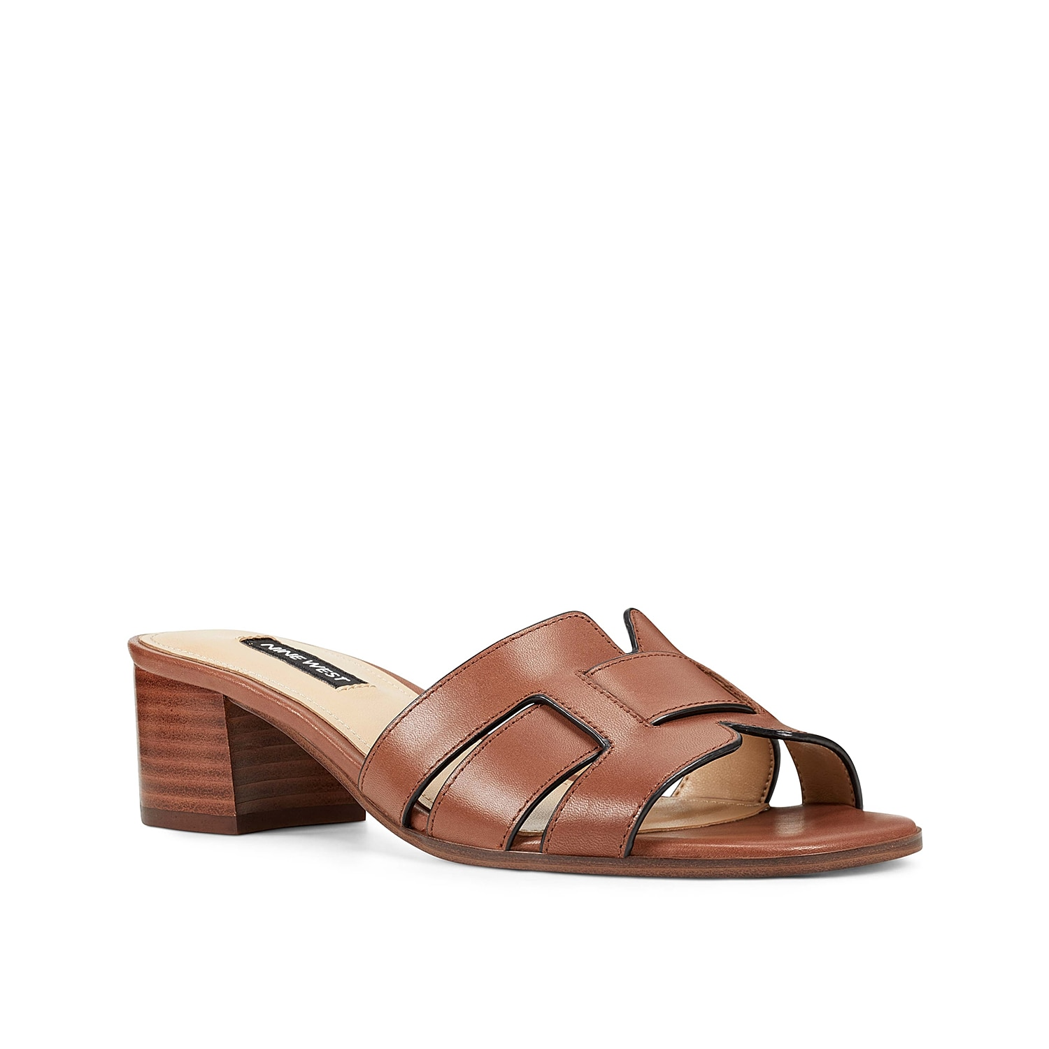 Slide into tailored appeal with the Gizella sandal from Nine West. This leather pair features intricately looped straps and a low block heel for modern style.