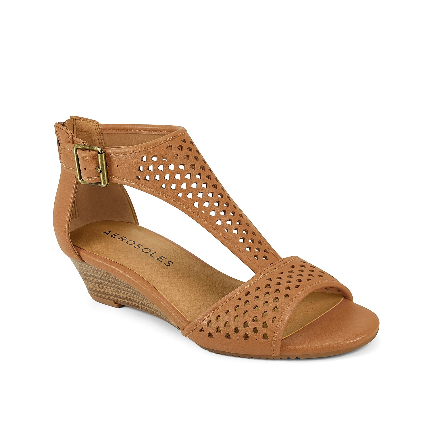 Style and comfort combine in the Sapphire wedge sandal from Aerosoles. This laser-cut pair features a memory foam footbed with Heel Rest Technology for daylong comfort.