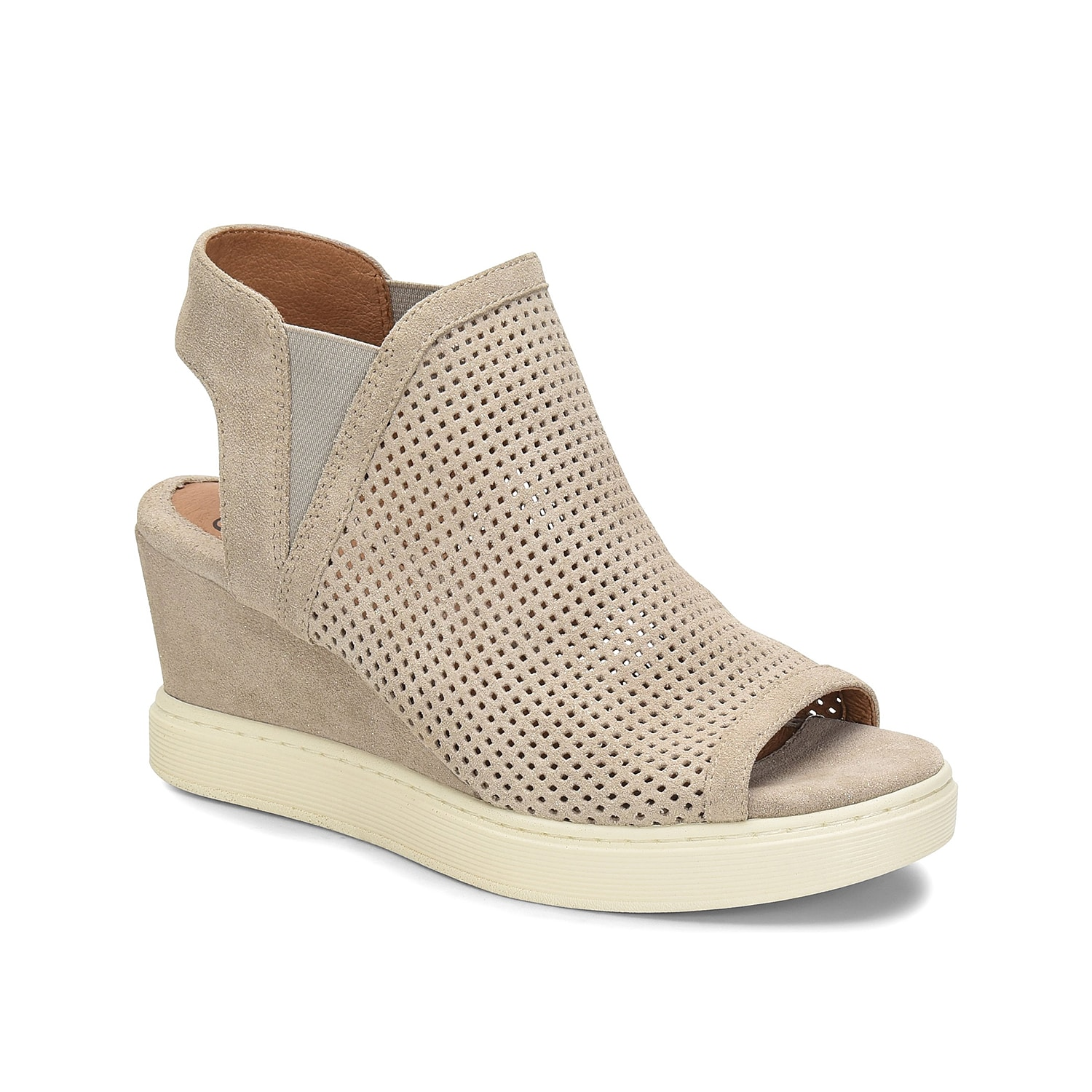 Sporty and comfortable, the Basima wedge sandal from Sofft will keep you looking and feeling your best. This laser-cut pair features a leather-lined footbed with extra cushioning at the ball, heel, and arch of the foot for daylong support.