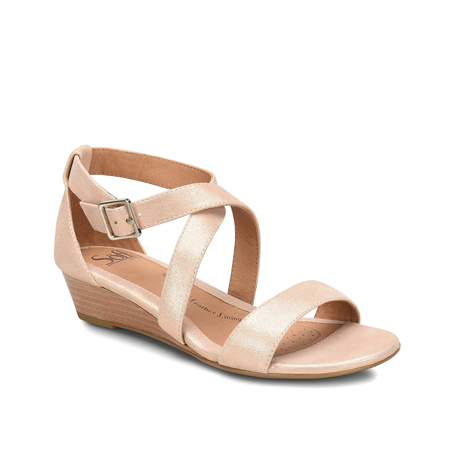 The Innis wedge sandal from Sofft features a classic design that is easy to pair with your whole warm weather wardrobe. This leather pair features a leather-lined cushioned footbed with extra arch support for daylong comfort.