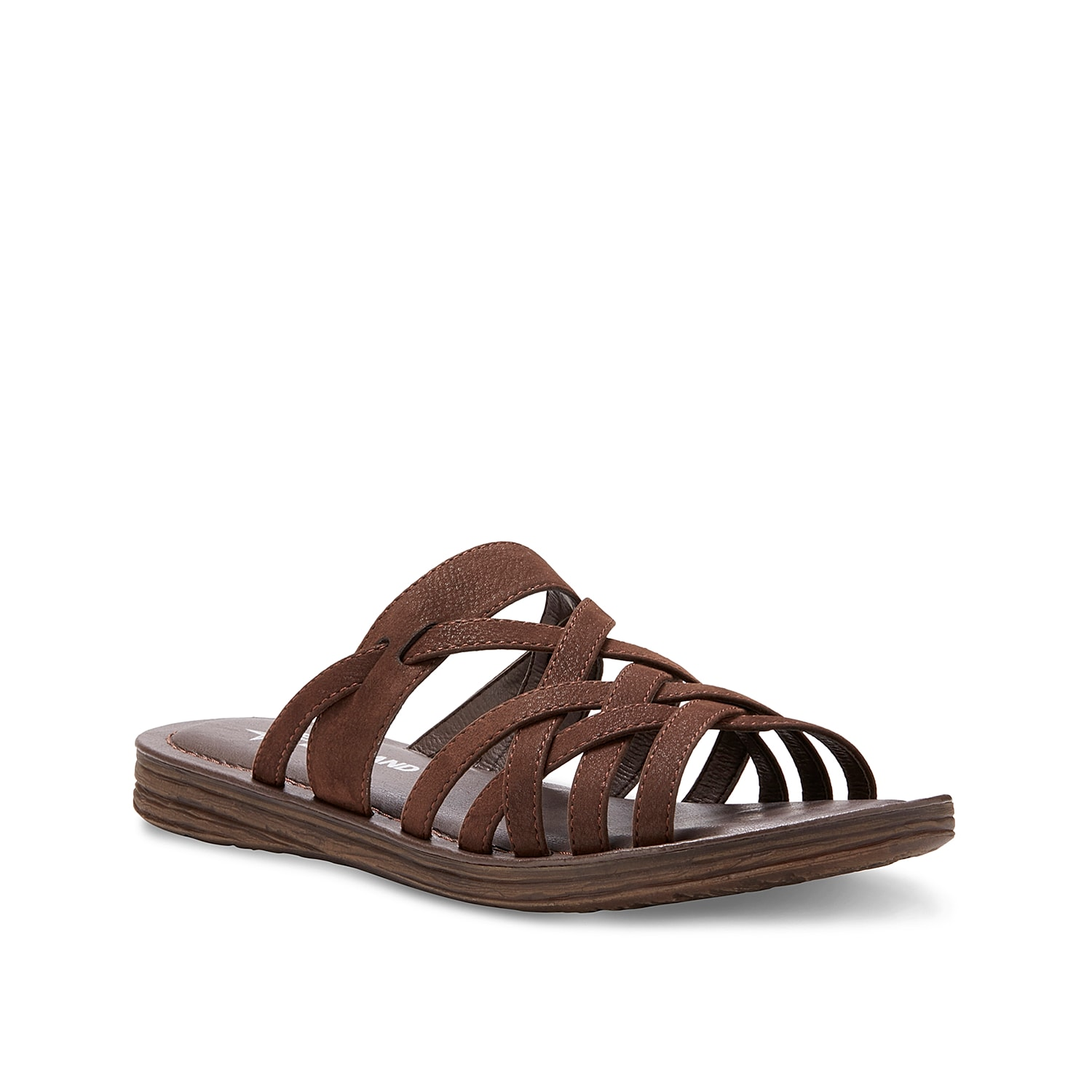 Slide into comfort and style with the Ellie sandal from Eastland. Interwoven straps create a secure fit while the memory foam footbed cushions every step.