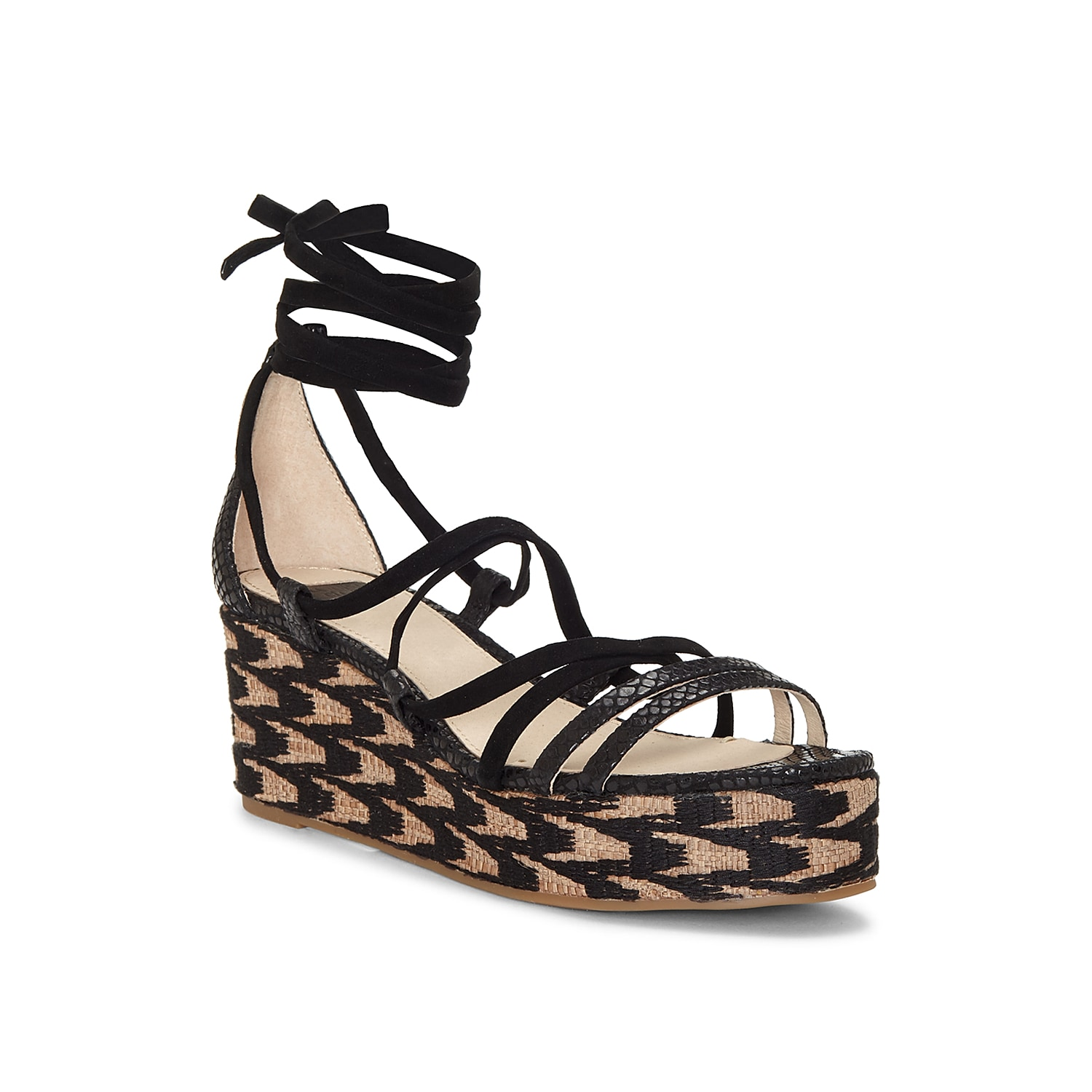 Spice up your shoe collection with the Renz wedge sandal from Louise Et Cie. This silhouette is fashioned with an espadrille heel and a wrap up ankle strap for eye-catching looks.
