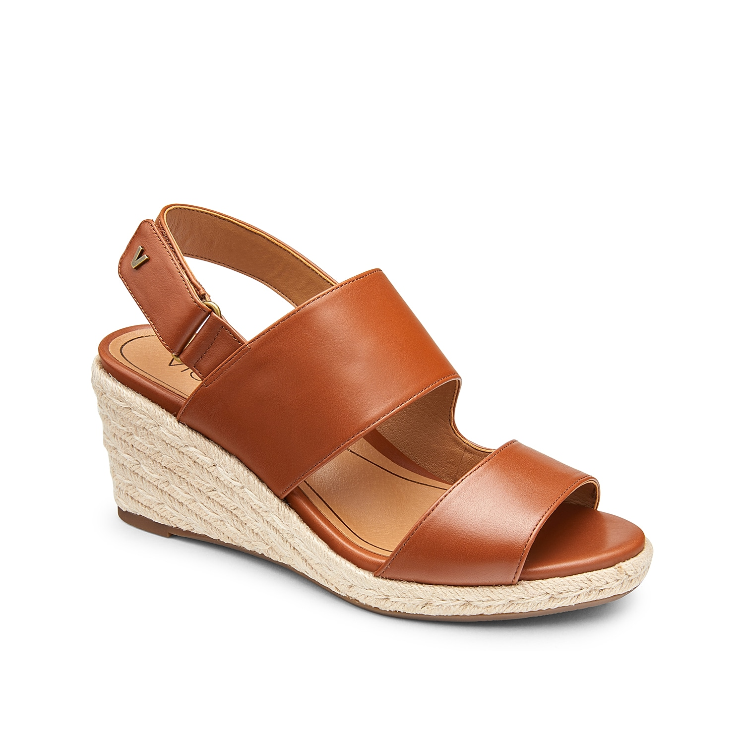 Elevate your sunny-day looks with the Brooke wedge sandal from Vionic. This leather pair is styled with broad straps, a beachy espadrille heel, and a hook and loop slingback strap for secure steps.