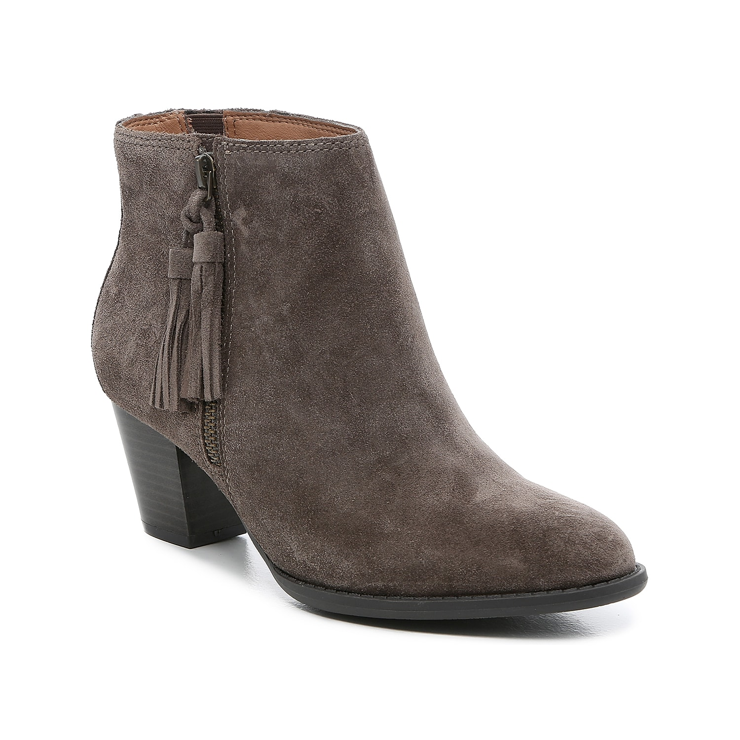 A simple suede pair, the Madeline ankle bootie from Vionic makes the most of your wardrobe with neutral hues and a modest, mid-height heel. A hidden elastic insert on the interior side provides a hint of stretch. Click here for Boot Measuring Guide.