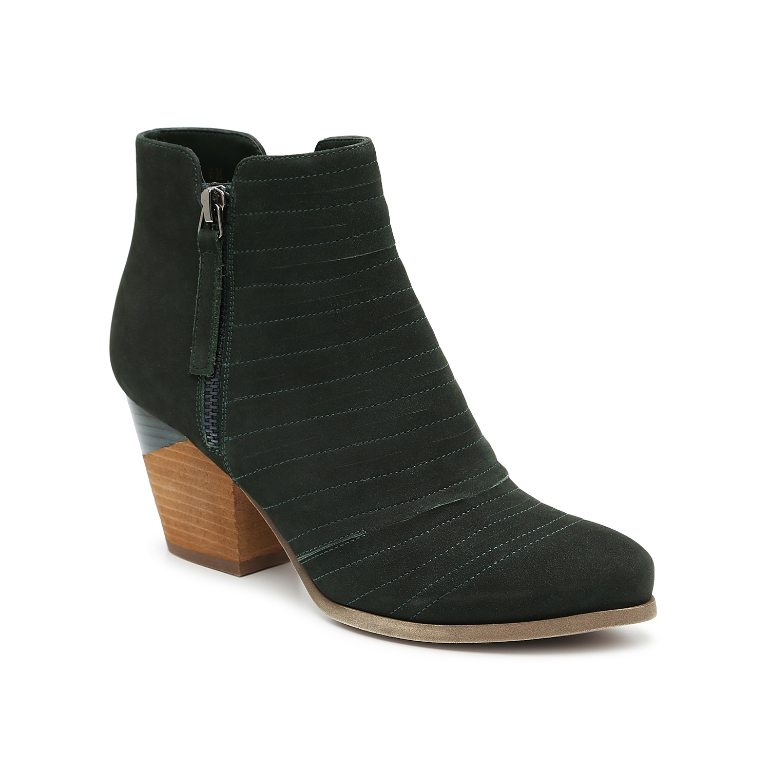 Precision cuts and contrast stitching accentuate the vamp of the Jeramy ankle booties from VANELi. A slanted block heel is split with two stacked styles with half-finished and half-raw texturing. Click here for Boot Measuring Guide.