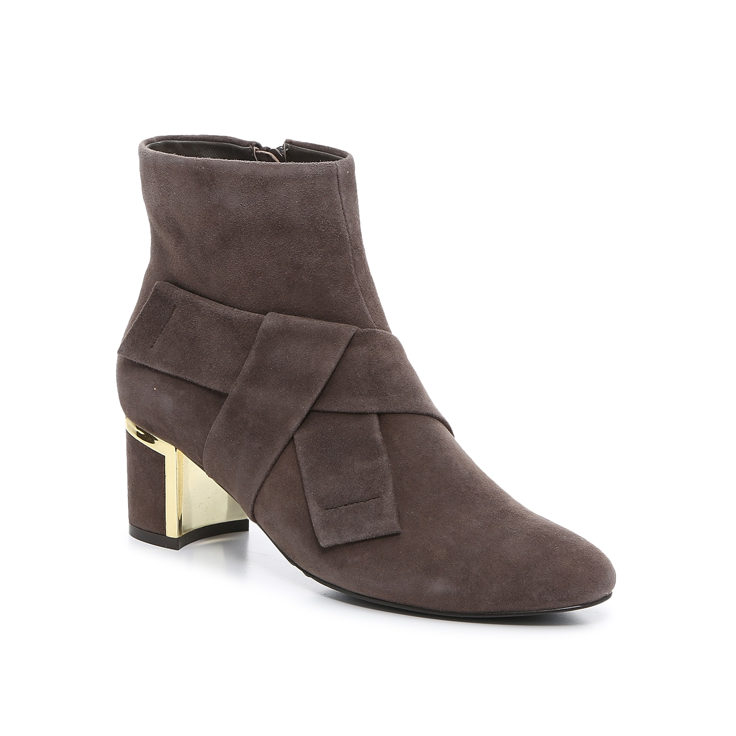 Rich suede and a bow-tied accent bring a sense of elegance to the Dadop ankle booties from VANELi. The mid-height heel is trimmed with a metallic rand that extends down the underside for a glimmer of silver.Click here for Boot Measuring Guide.