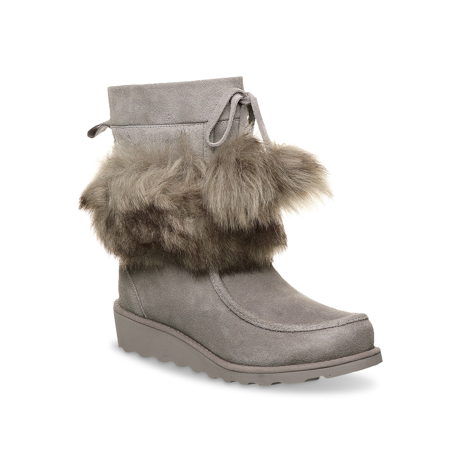 Playful yet practical at the same time, the Bearpaw Arden wedge bootie is a versatile companion. Highlighted with faux fur pom poms, this bootie has comfort shearling footbed and lightweight blown rubber sole.Click here for Boot Measuring Guide.