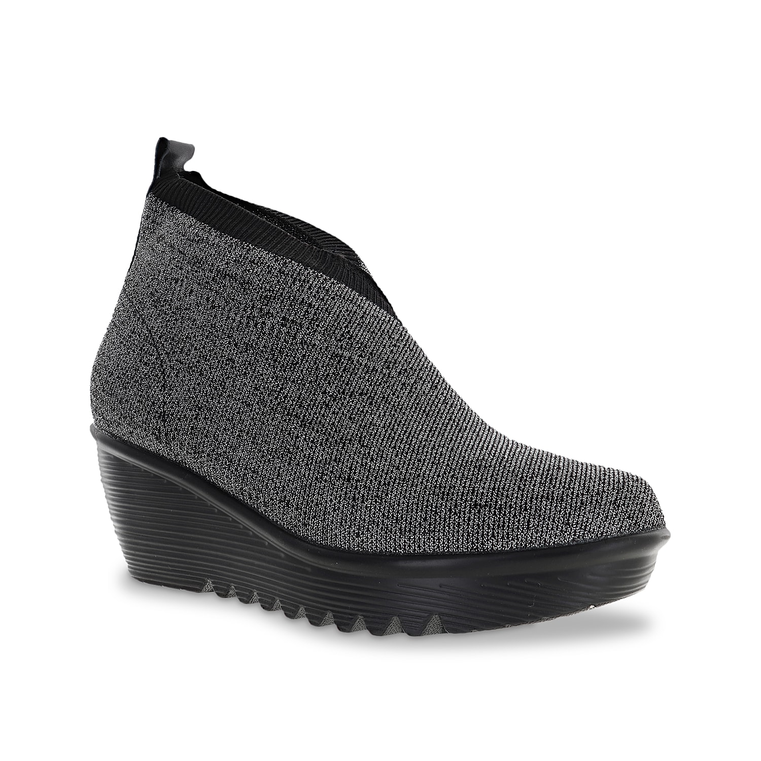 The Sally wedge slip-on from Bernie Mev adds instant chic sophistication along with cushy comfort. This wedge slip-on has a stretchy upper with a wrapped look, ribbed cuff, a leather pull loop, and cozy memory foam padding.