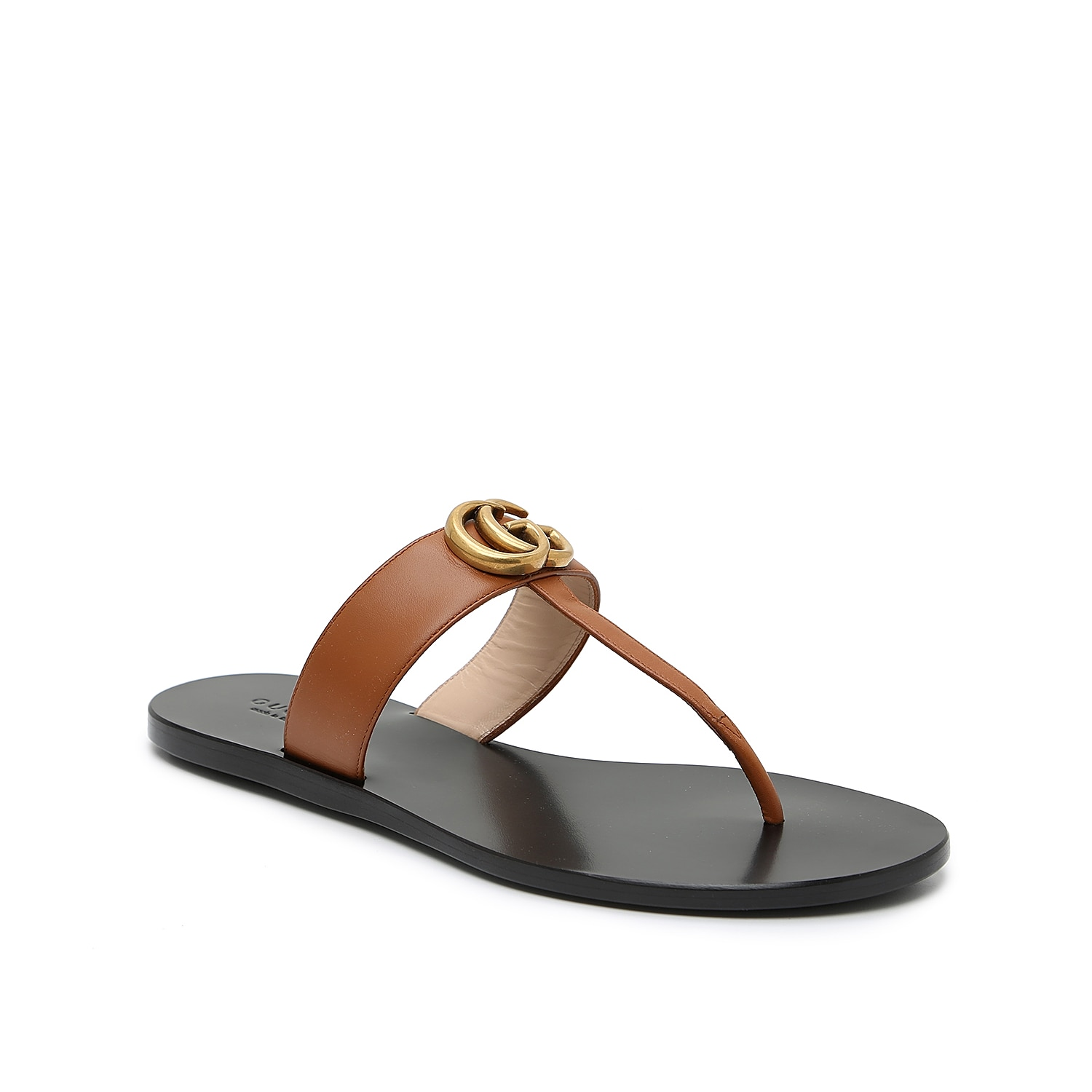 Embellished with archival Double G hardware inspired by 1970s Gucci fashions, the Marmont thong sandals are effortlessly simple to wear and style. Supple Italian-crafted leather creates a smooth textural finish and a minimal T-strap silhouette with a heel-less outsole feels like a barely-there fit.  Made in Italy from carefully selected materials. To extend product life, protect from direct light, heat, and rain. Fill shoe with tissue paper to help maintain the shape and absorb humidity. Store in the provided flannel bag and structured shoe box.